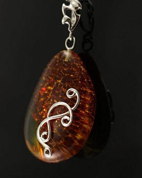 A Charming Silver Pendant With Natural Baltic Amber Golden Honey Color